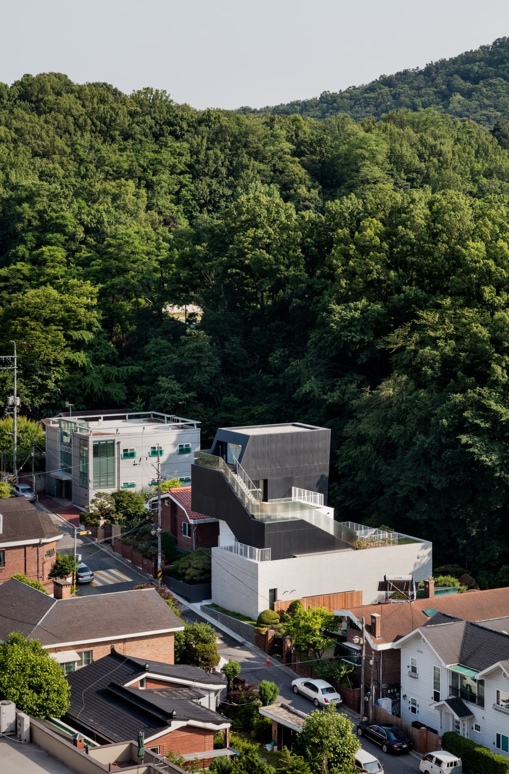 This is an aerial view of the house showcasing how it stands out against the surrounding houses and landscape.