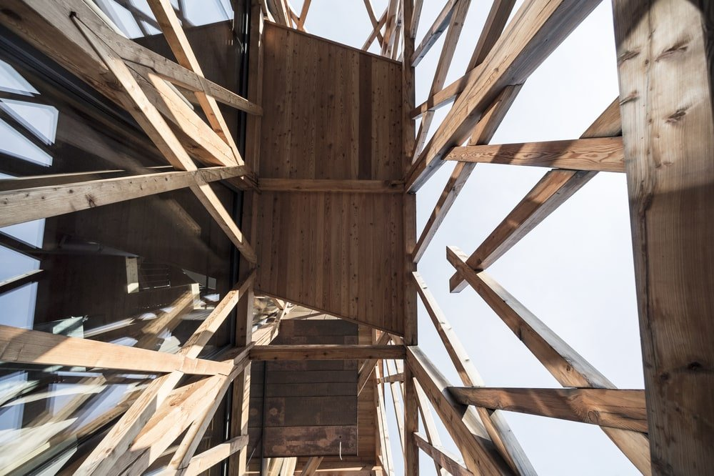 This is a look up the exterior wooden accents of the house.