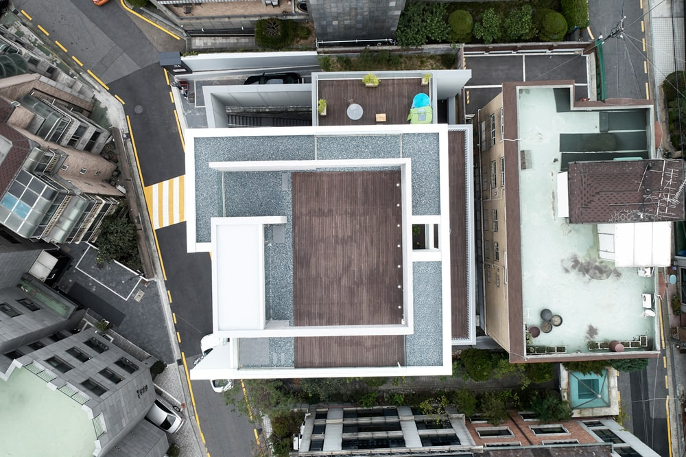 This is a top aerial view of the building showcasing its unique design and its multiple terraces.