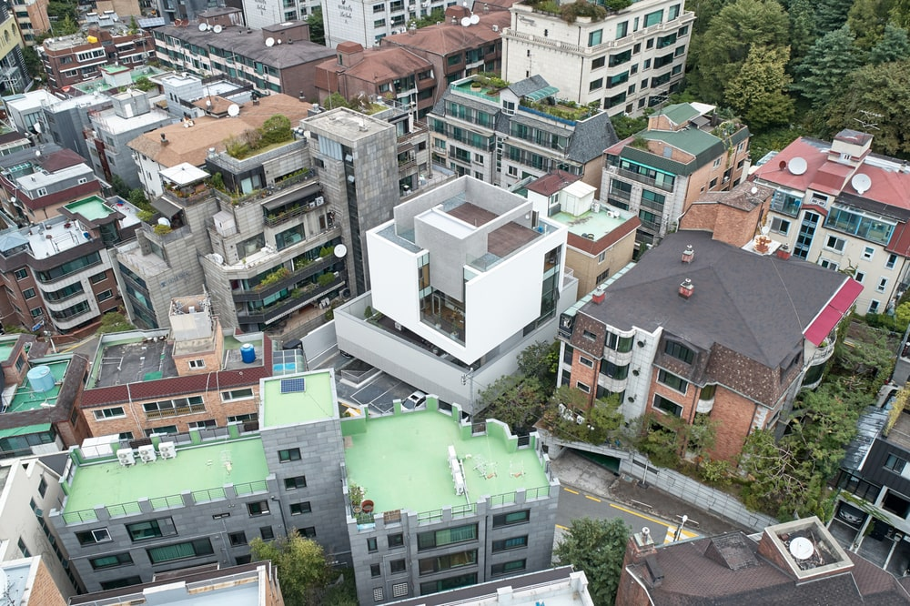 This is an aerial view of the building showcasing its unique shape that makes it stand out against the surrounding structures.