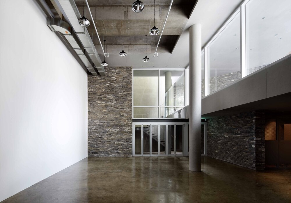 This is a look at the interior that has a tall ceiling and large transom window that brings in natural lights.