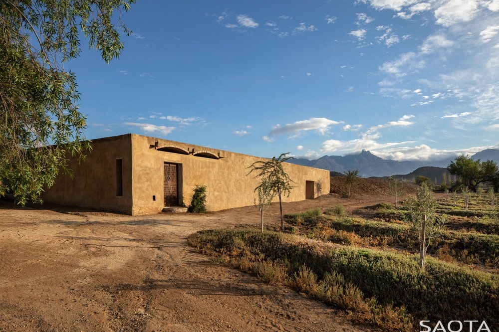 This structure has a more earthy tone to its exterior walls making it blend with the terrain.