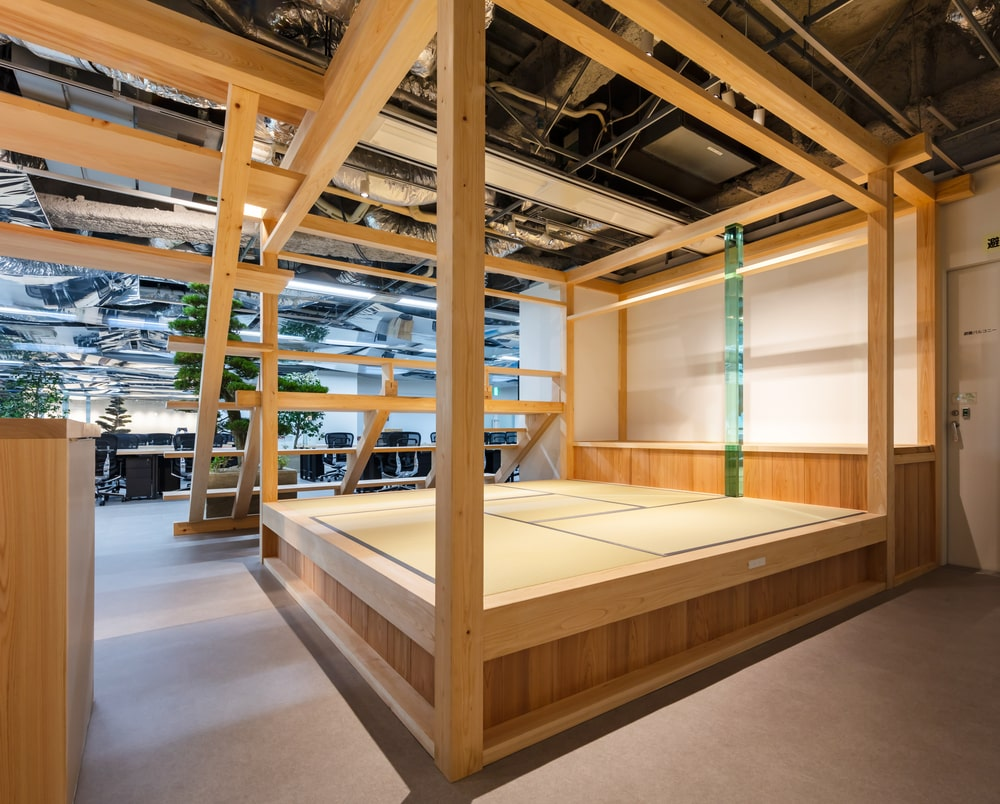 The tatami floor is on a wooden platform with wooden pillars for support.