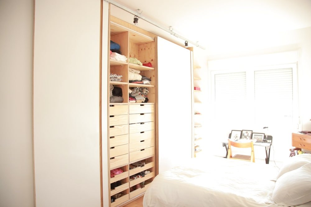 This is the bright bedroom with an abundance of natural light coming in from the window.