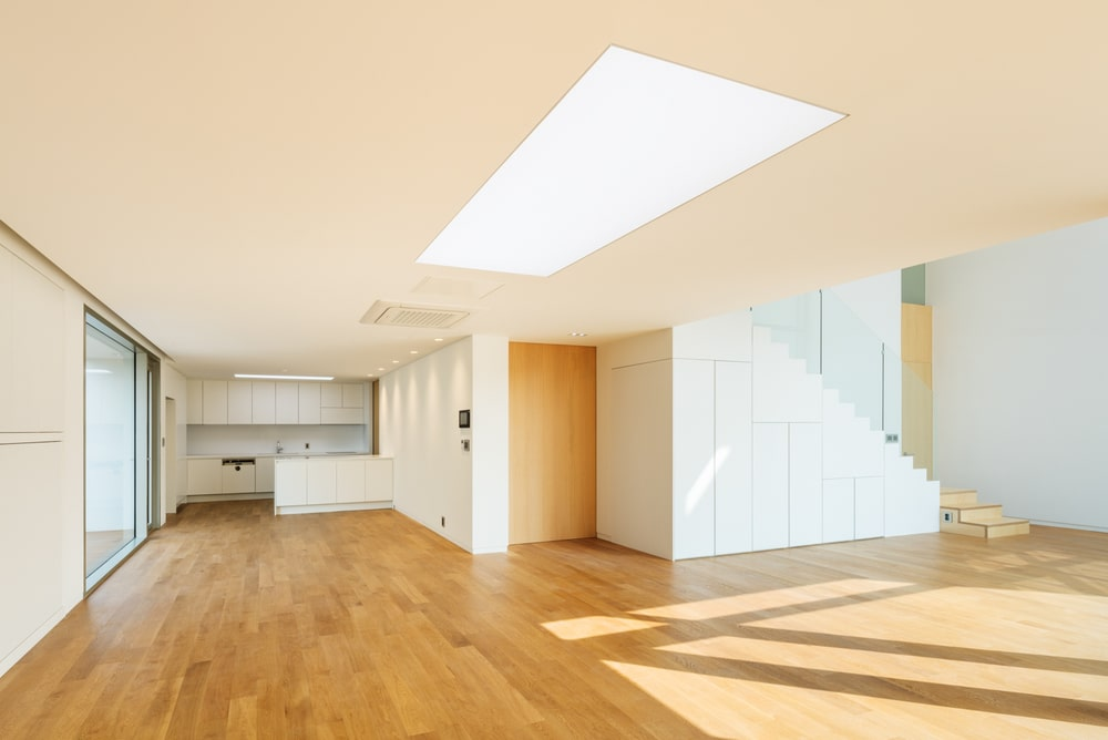 This is an interior view of the house showcasing a large open room with a skylight in the middle.