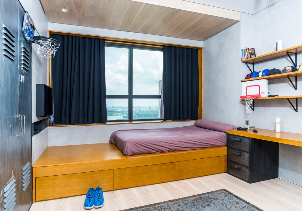 This other bedroom also has a large wooden platform with a bed cushion on top and wooden drawers underneath to maximize the storage capabilities.