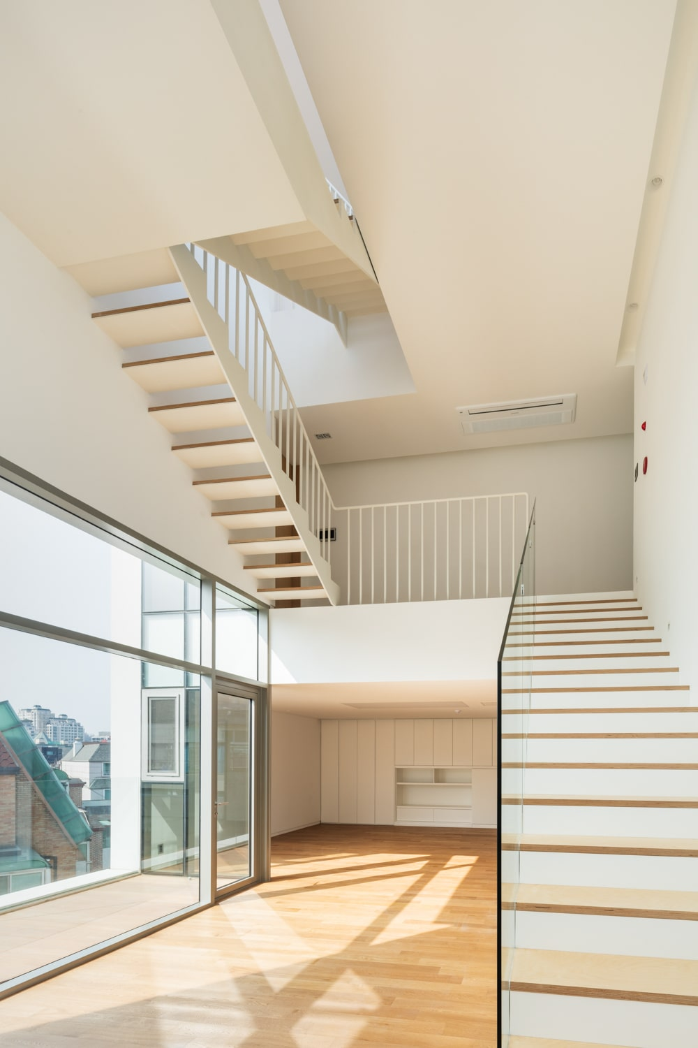 The natural lights coming in pair well with the beige walls and beige ceiling of the large area.