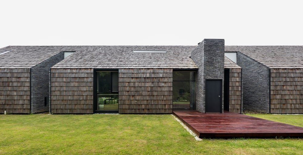 This close look at the house exterior showcases the exterior walls that has the same material as the roof.