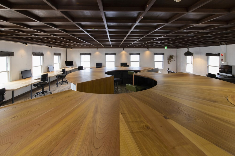 This is a close look at the large curved wooden structures of the office booths.