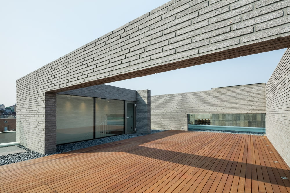 The walls of the rooftop area has tiles that resemble brick.