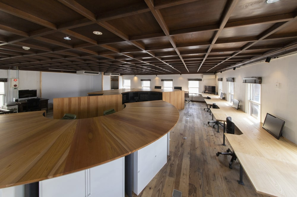 Here you will see the white storage area underneath the table of the curved wooden structure.