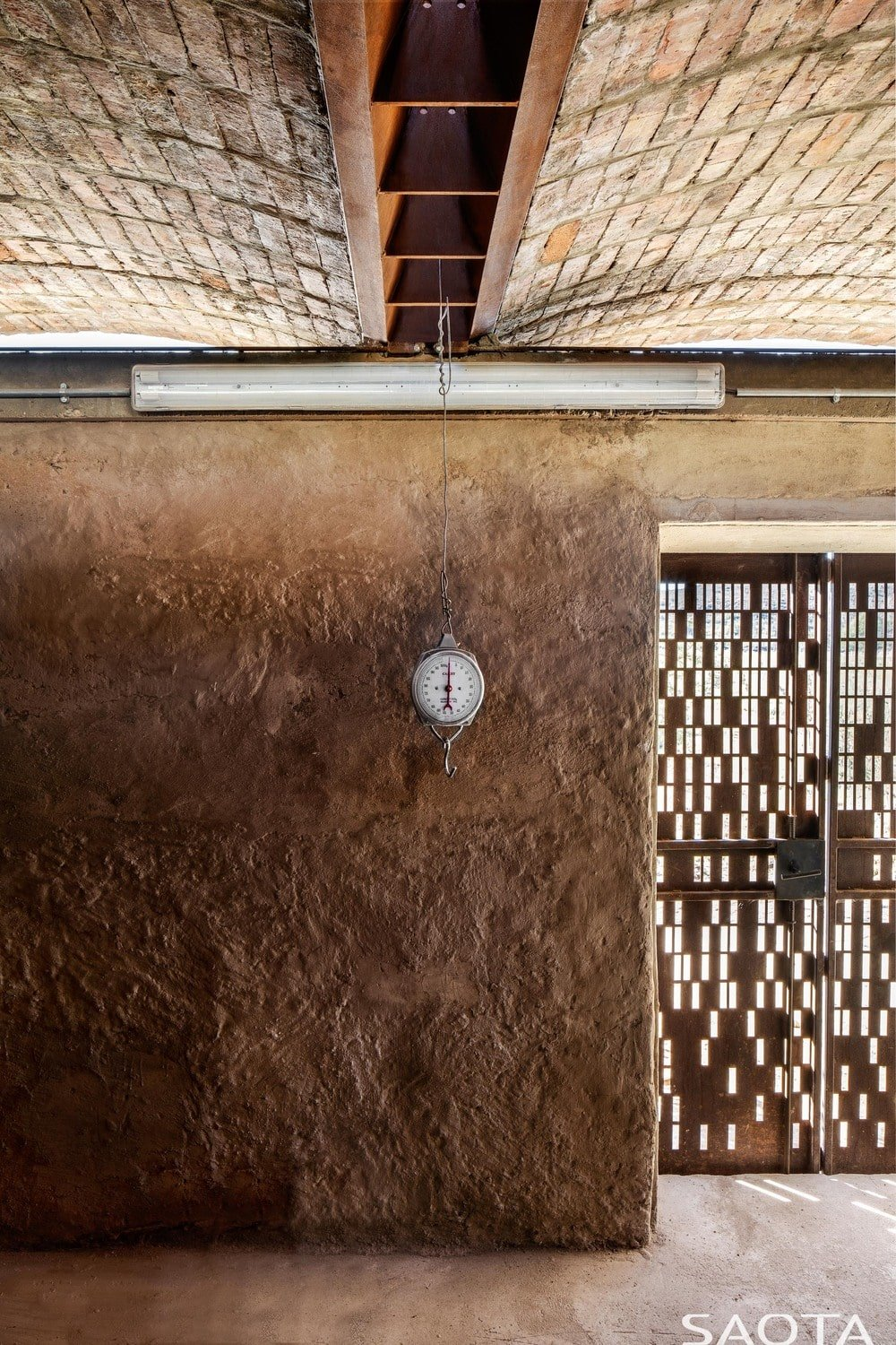 This is a closer look at the textured earthy wall and the brick ceiling.