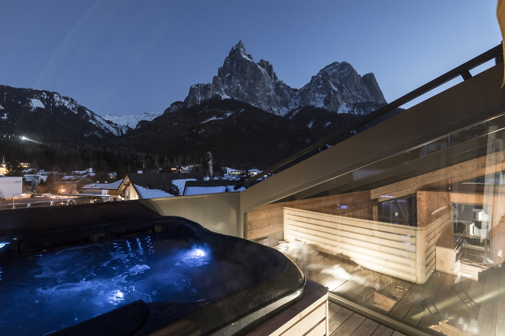 The house also has an outdoor hot tub with a view of the mountains.