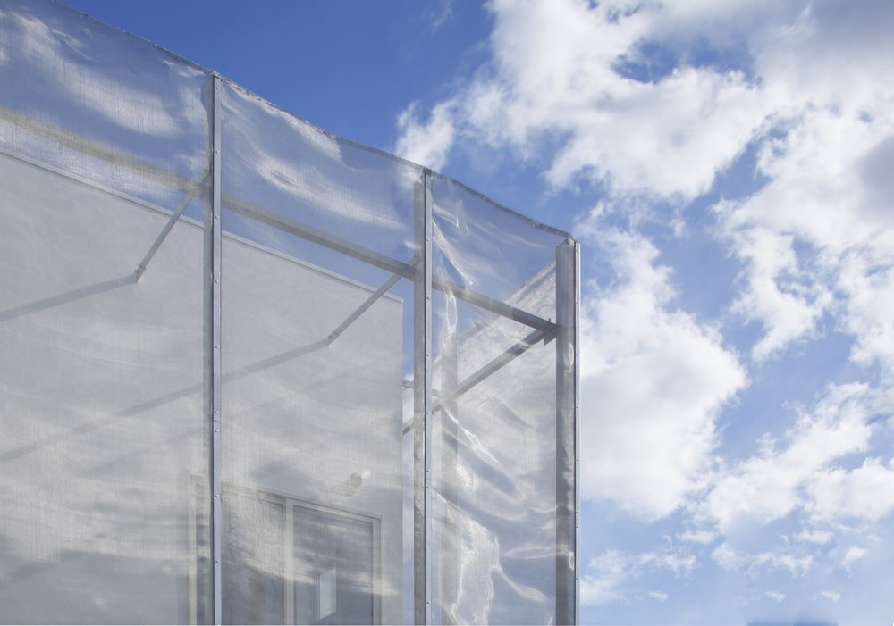This is a closer look at the see thru screen-like material that covers most of the exteriors of the house.