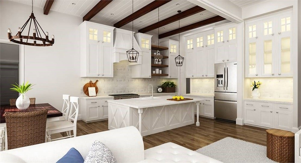 This is a full view of the kitchen that has white wooden structures like cabinets and kitchen island that stand out against the hardwood flooring and the exposed dark wooden beams of the ceiling.