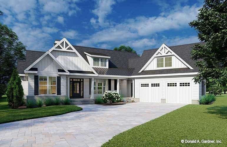 This is the single-story farmhouse-style home with bright white exterior walls that are contrasted by the dark gray roof and the grass lawns flanking the concrete driveway.