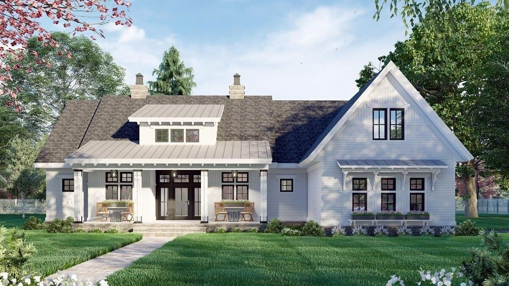 This is a two-story modern farmhouse-style home with dark gray roof and light exterior walls that make the frames of the windows and doors stand out.