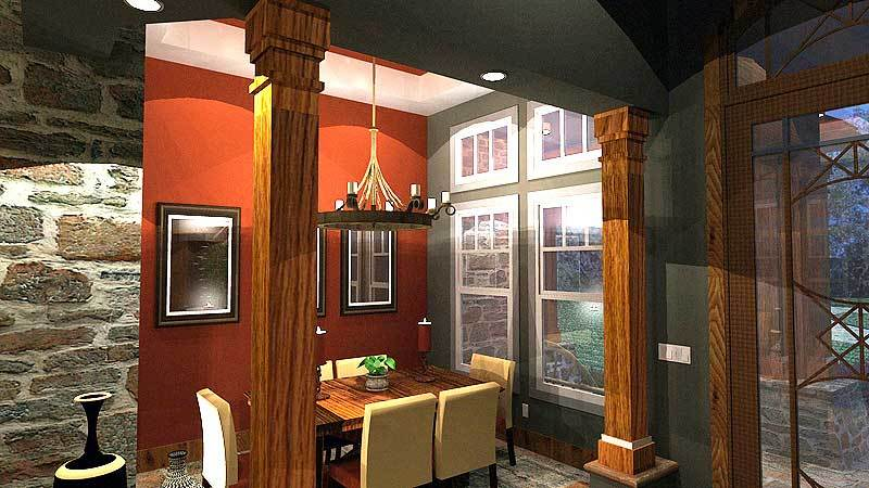 This is a look at the dining room of the house through an entryway with a couple of thick wooden pillars that match the dining table.