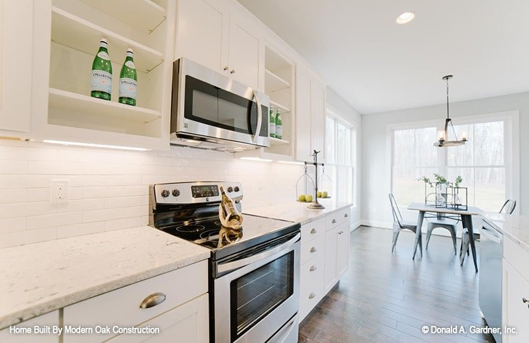 The kitchen sits beside the bright dining area for convenient serving.