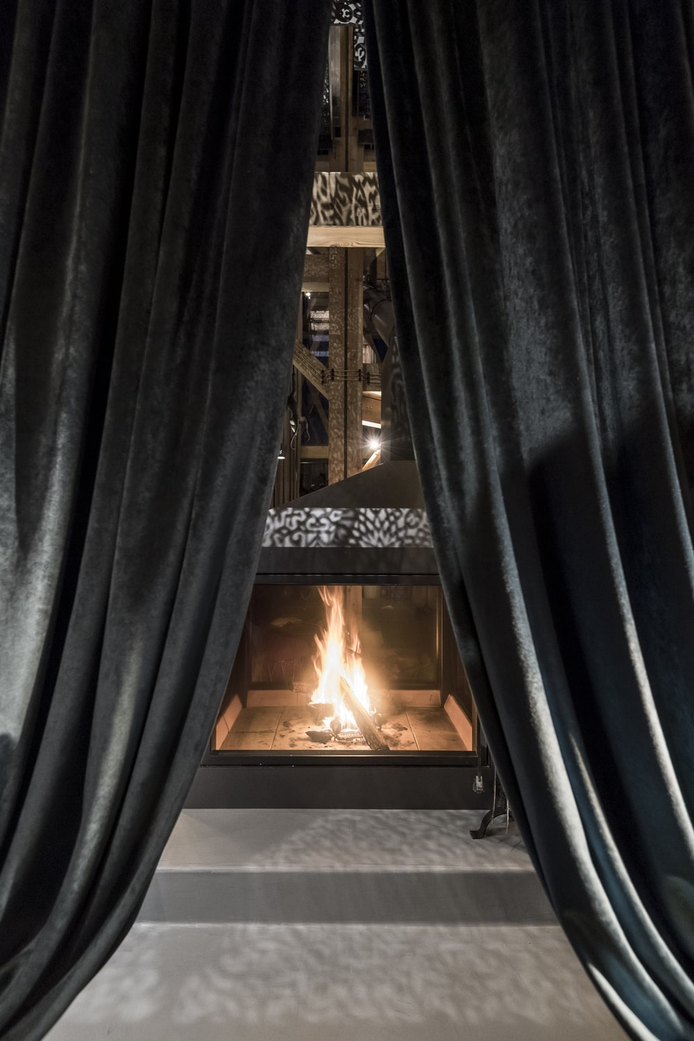 This is a close look at the large fireplace with intricate designs on it.