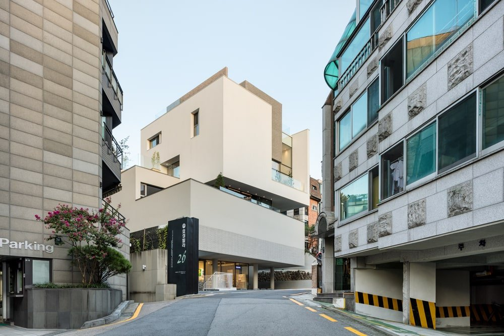 This is a view of the building from the vantage of the street shpwcasing its unique shape and design.