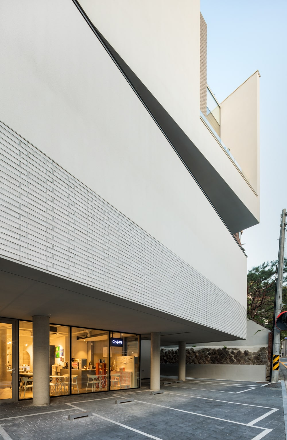 The wall above the main entrance of the building has a wall tile accent to it resembling bricks.
