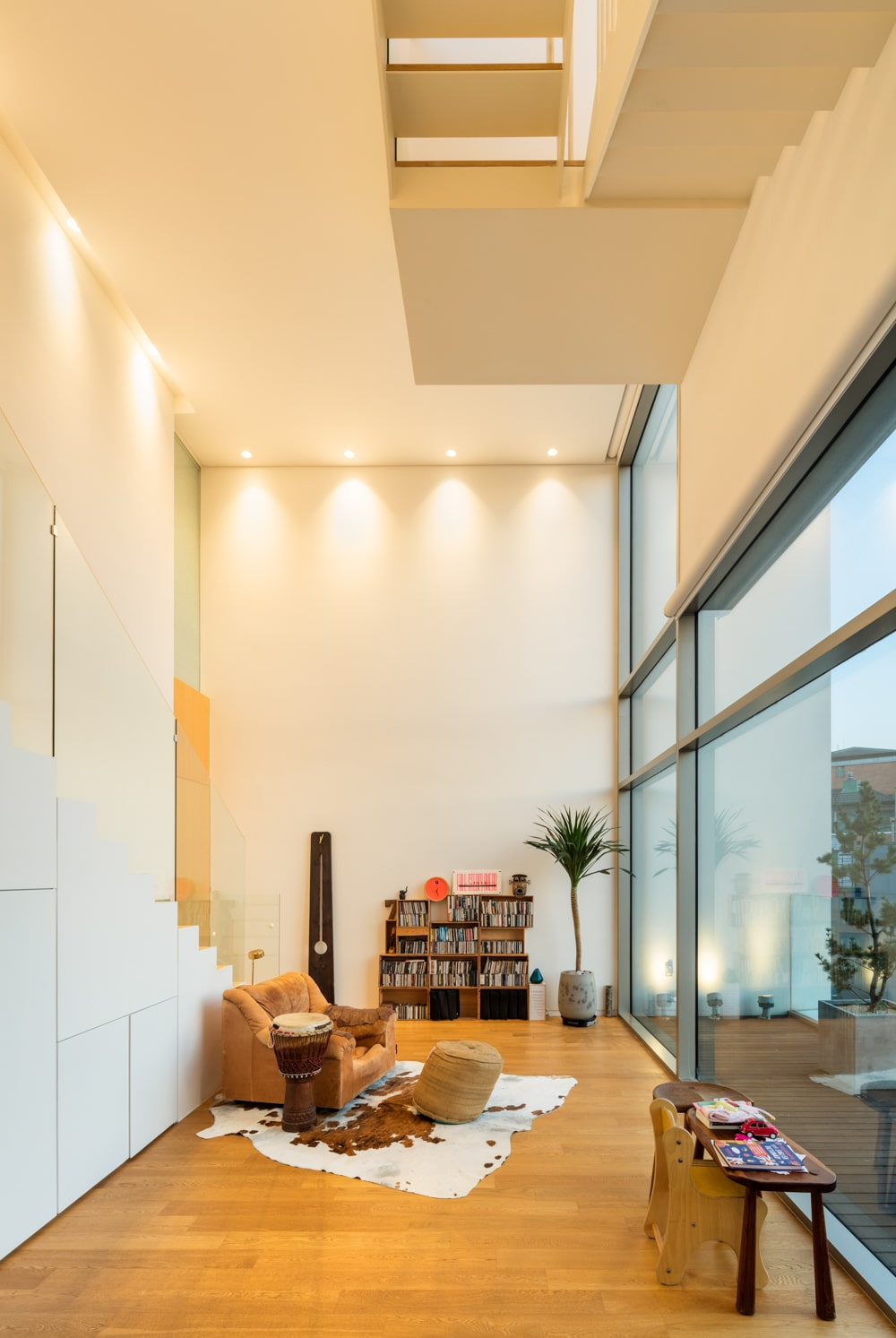 The interior has a tall ceiling with beige walls that match and complemented by recessed lights.