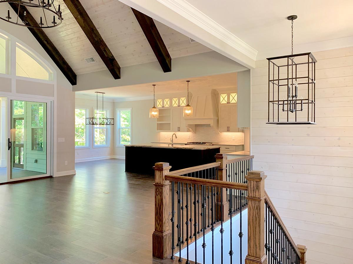 The living room topped with a vaulted ceiling opens up to the kitchen.