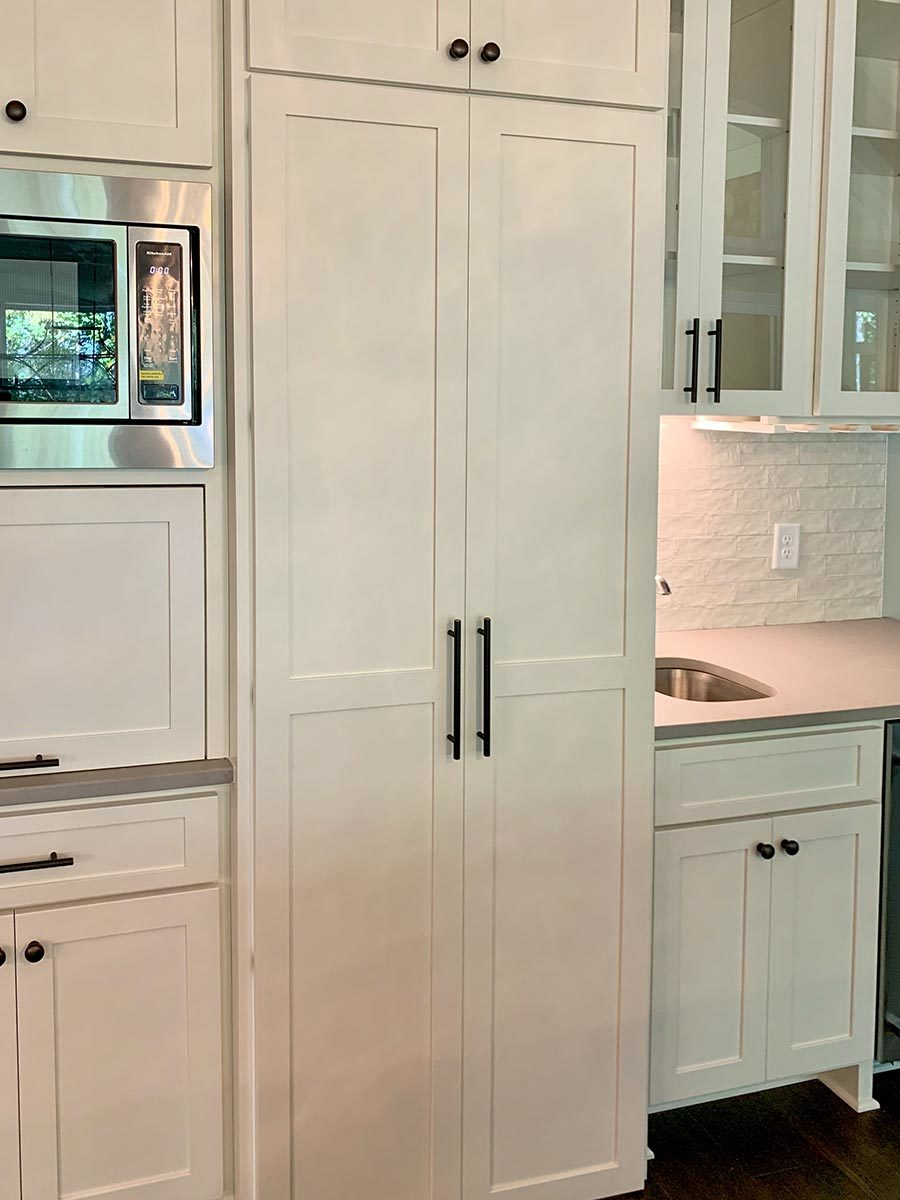 This cabinet with a double door conceals the walk-in pantry.