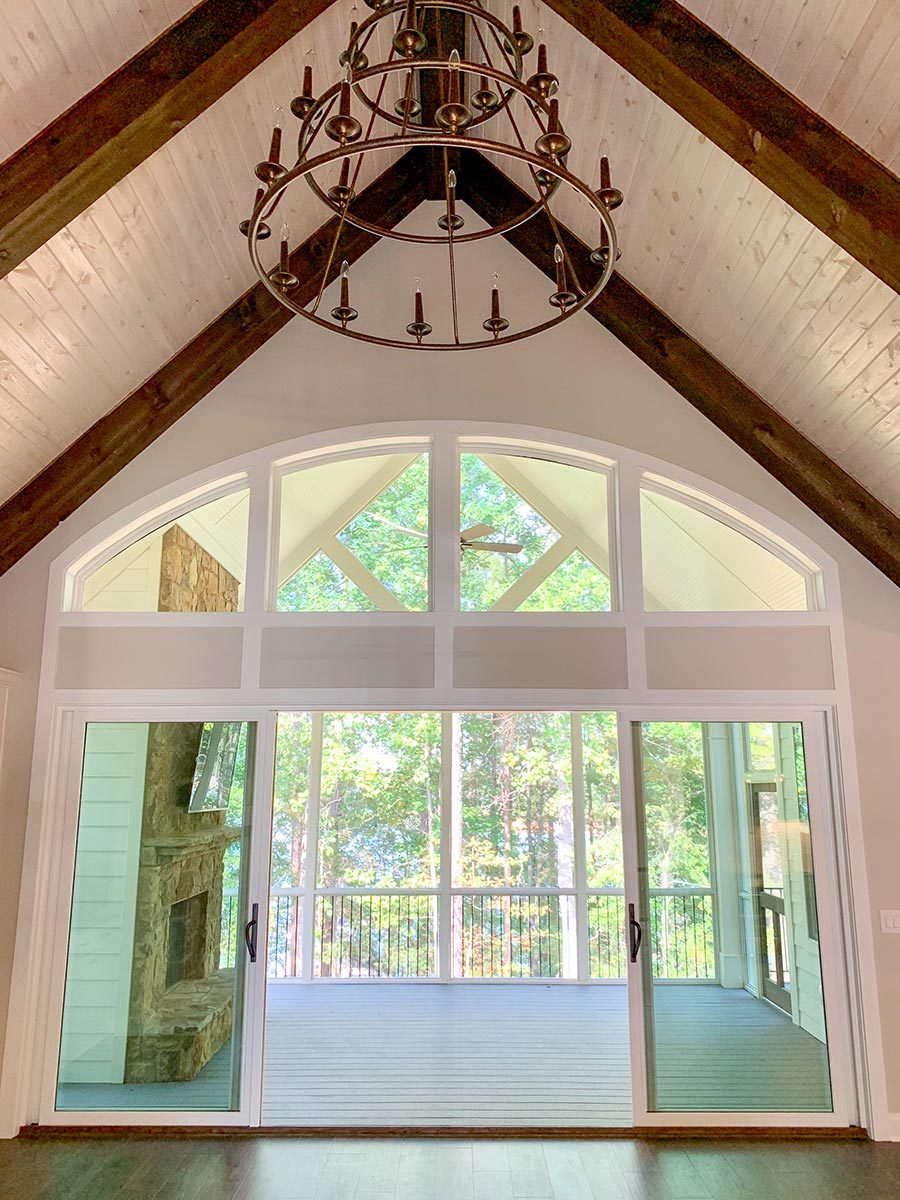 Glass sliding doors in the living room open to the screened porch.