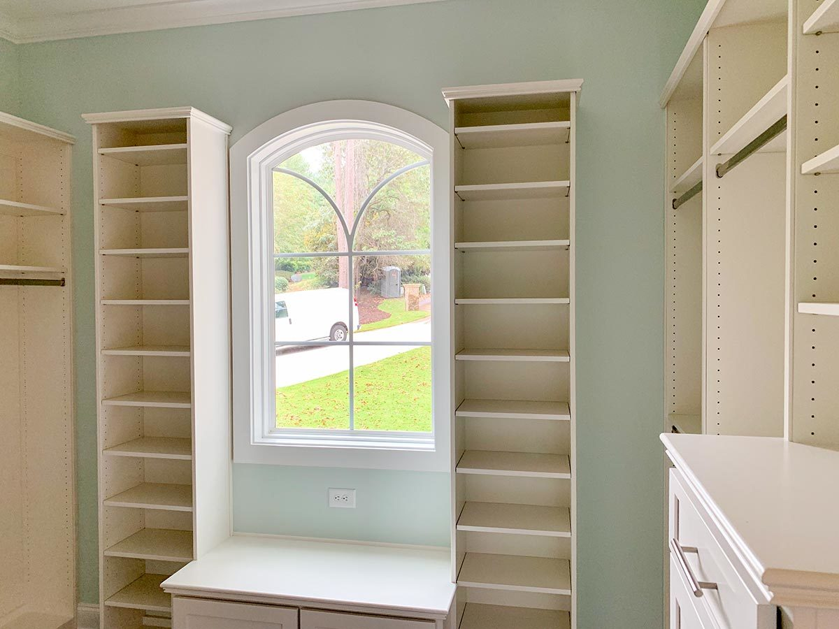 There's also an arched window placed above the built-in seat.