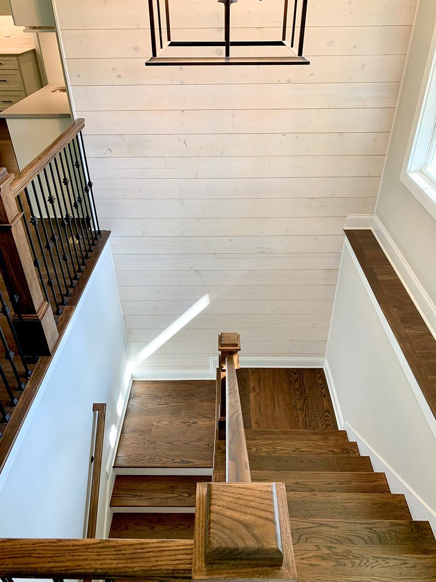 Top view of the wooden staircase leading down the basement.