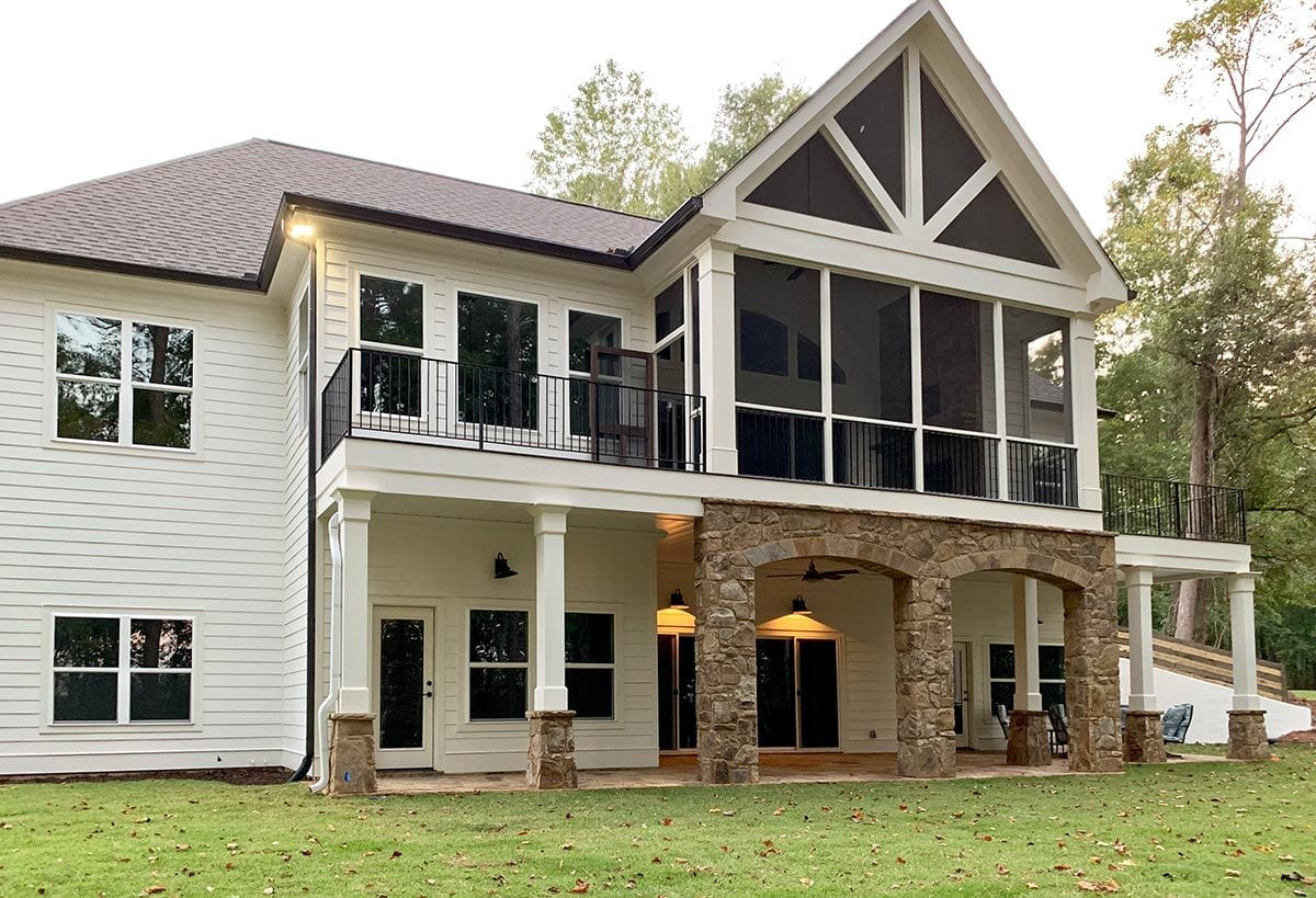 There are also decks flanking the screened porch with a gable roof.