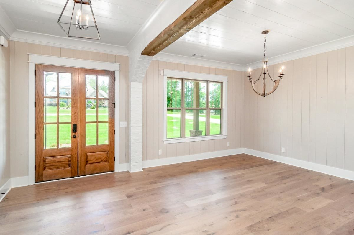 A french door welcomes you into the foyer which opens completely to the dining room.