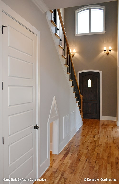 Upon entering the foyer, a staircase fitted with storage space greets you.