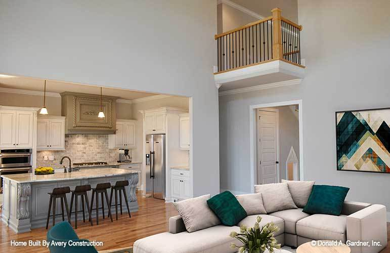 The kitchen opens completely to the two-story living room.
