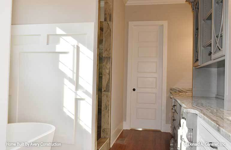 The primary bathroom offers a toilet room, walk-in shower, a freestanding tub, and a marble top vanity.