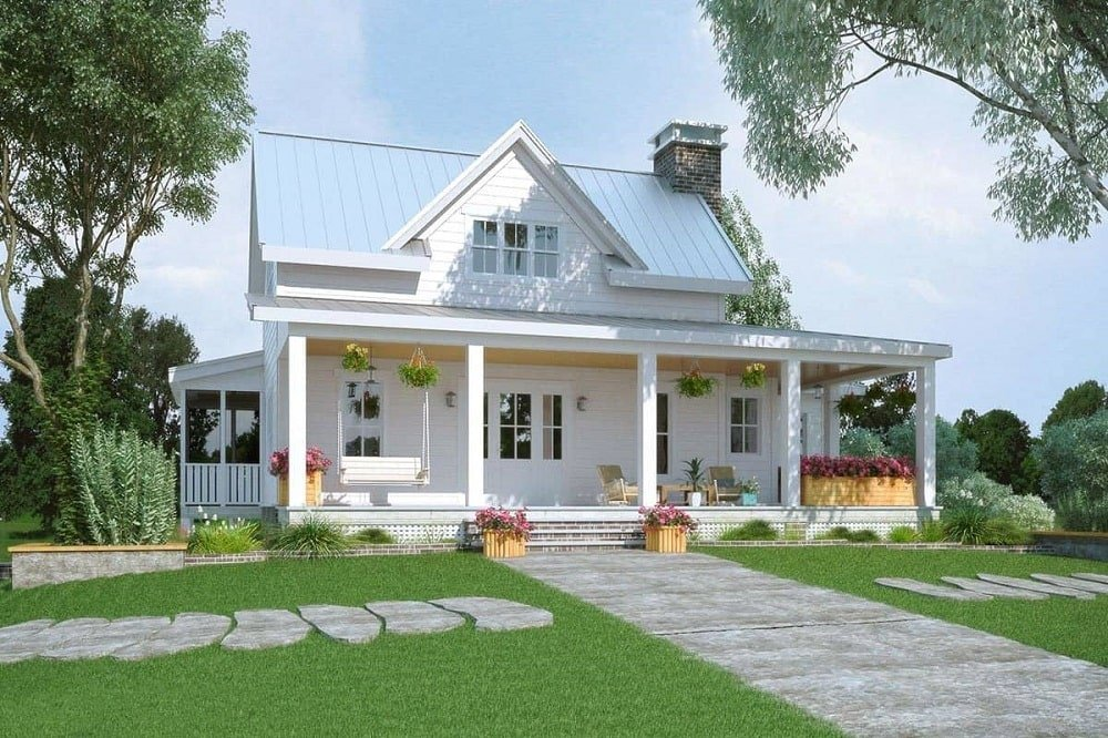 This front view of the modern two-story farm-style home has a stone walkway through the lawn to the front porch that has various planters and potted plants.