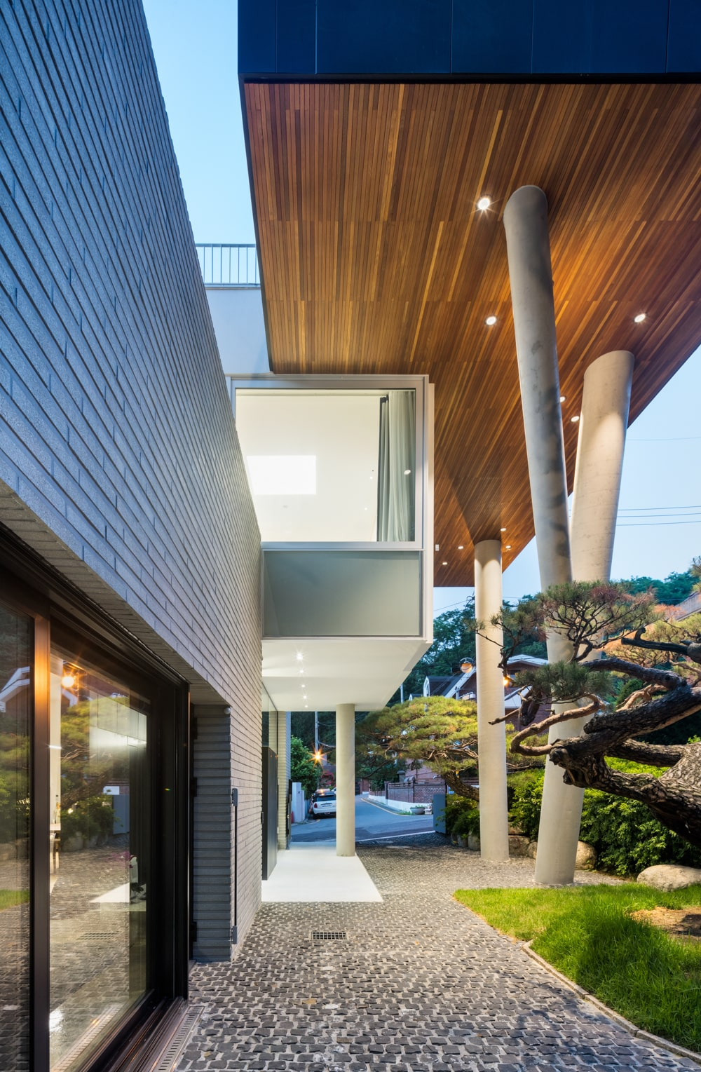 This structure over the main entrance of the house also serves as the cover with a tall wooden ceiling.