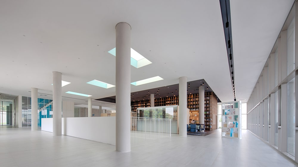 This is a closer look at the upper floor that features the bright skylights that bring in natural lighting for the white walls, ceiling and floor.