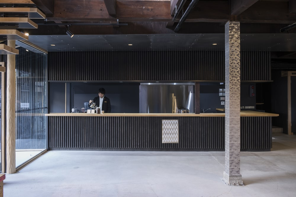 This is a close look at the large dark-toned structure that serves as a bar and reception area.