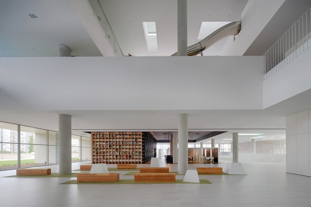 This is a view of the ground floor lobby with multiple sitting areas, a bright and spacious design along with an abundance of natural lighting.