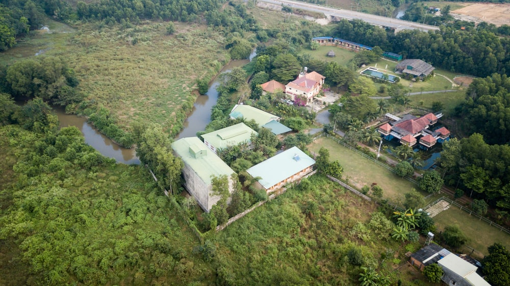 This is an aerial view of the dormitory showcasing the surrounding area and the landscaping.