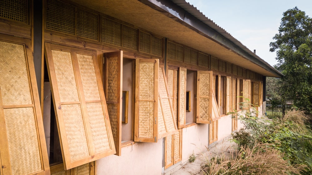 This is a view of the back of the dormitory with windows made of woven wicker.