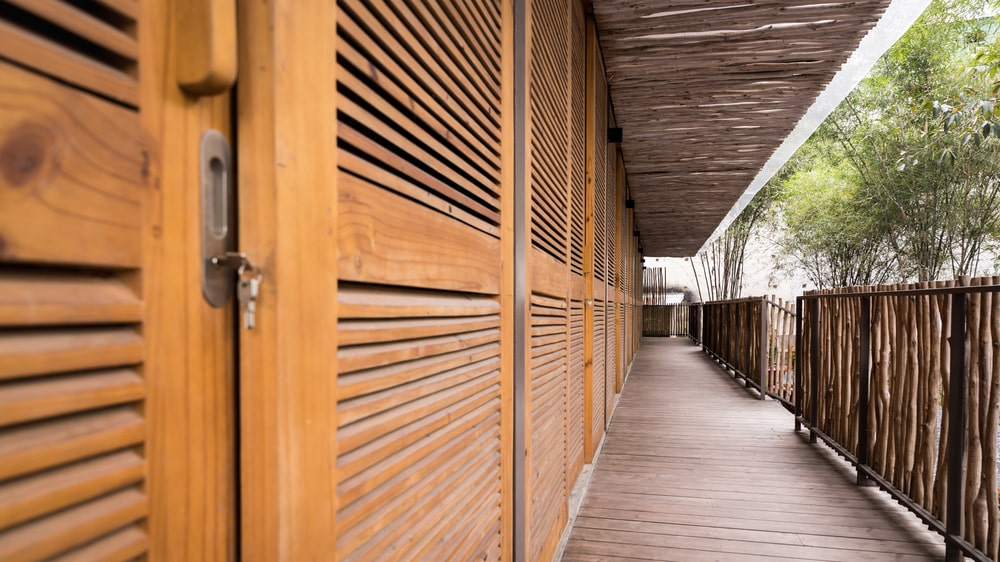 This is a close looka t the wooden doors of the dormitories with vents for ventilation.