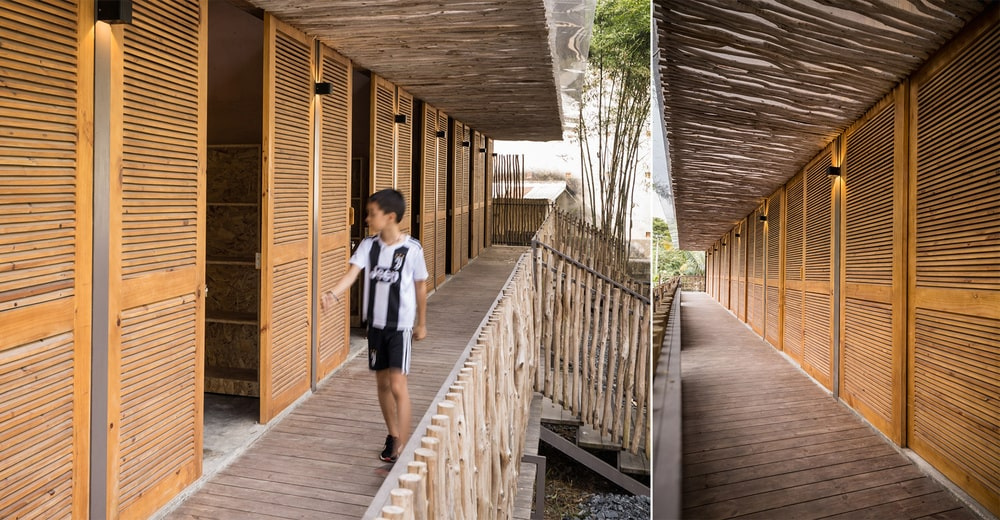 This view of the individual dormitories shows that there are exterior wall-mounted lamps in between doors.