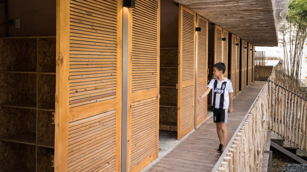 This is a close look at the wooden doors and the bamboo railings at the side.