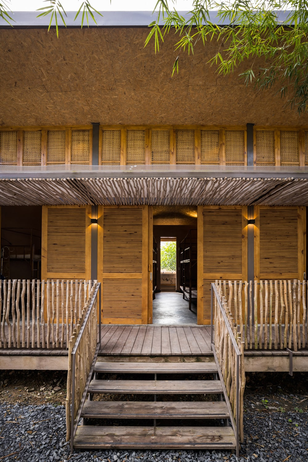 This is a close look at the wooden steps of the porch and bamboo accents on the walls.