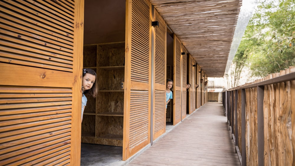 This is a view of the covered walkway that has bamboo accents on the ceiling.