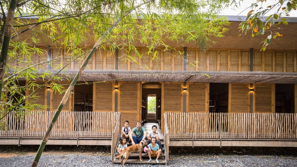 This is a view of the large dormitory that has bamboo elements on its walls and structure.